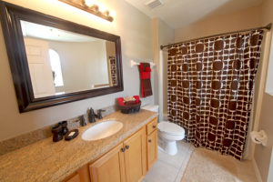 Shower curtains divide the space while providing more privacy and color