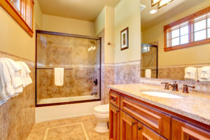 Glass doors frame the shower while not detracting from the space
